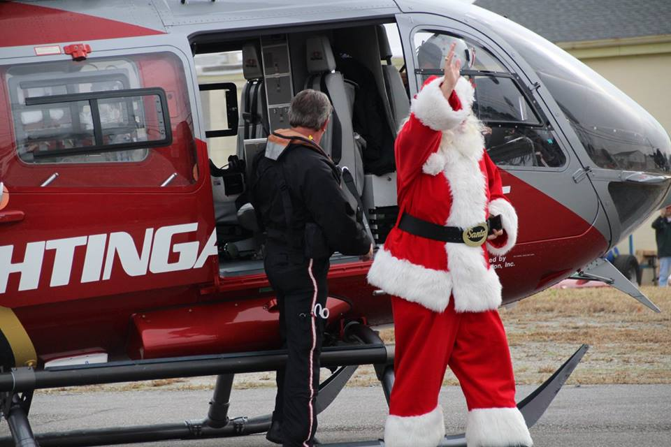 Santa flies into Toys for Tots